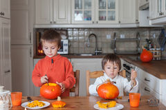 Two adorable boys, preparing jack o lantern for Halloween Royalty Free Stock Photography