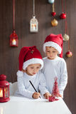 Two adorable boys, writing letter to Santa Royalty Free Stock Photo