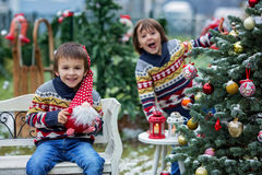 Two adorable children, boy brothers, having fun outdoors in the Royalty Free Stock Images