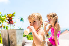Two adorable children eating yoghurt Stock Images