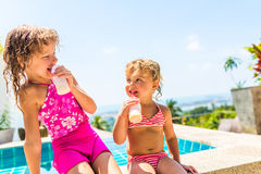 Two adorable children eating yoghurt Royalty Free Stock Photos