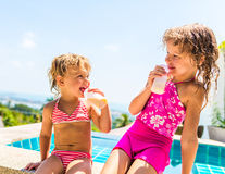 Two adorable children eating yoghurt Royalty Free Stock Photography