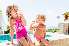 Two adorable children eating yoghurt Royalty Free Stock Image