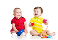 Two adorable children playing with toys. Toddlers Royalty Free Stock Photos