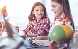 Two adorable clever girls working on group project Stock Photography