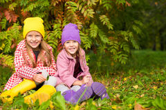 Two adorable girls in forest at warm sunny autumn Stock Photography