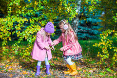 Two adorable girls in forest at warm sunny autumn Royalty Free Stock Photos