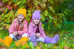 Two adorable girls in forest at warm sunny autumn Royalty Free Stock Photo