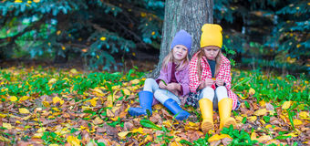 Two adorable girls in forest at warm sunny autumn Stock Images