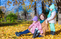 Two adorable girls with his young mom in the park Royalty Free Stock Photo