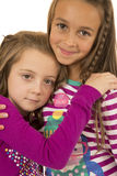 Two adorable girls hugging wearing winter pajamas with a fun expression Stock Photo