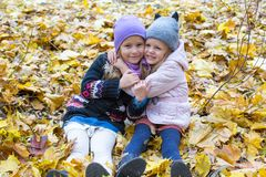 Two adorable girls outdoors in autumn day Royalty Free Stock Images