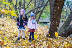 Two adorable girls outdoors in autumn forest Stock Photography