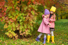 Two adorable girls outdoors in autumn forest Stock Image
