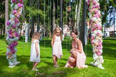 Two adorable girls with their mother outdoor at Stock Photography