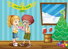 Two adorable kids exchanging their christmas gifts Stock Photography