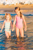 Two adorable kids playing in the sea on a beach Royalty Free Stock Images