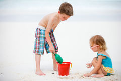 Two adorable kids playing together at beach Royalty Free Stock Image