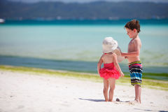Two adorable kids standing by ocean shore Royalty Free Stock Images