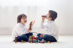 Free Two Adorable Little Children, Boy Brothers, Having Fun Eating Ch Stock Images - 67718894