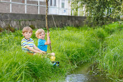 Two adorable little friends  fishing with selfmade rod Stock Photography