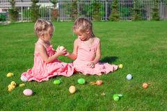 Two adorable little girls playing with Easter Eggs Stock Images