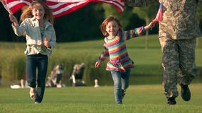 Two adorable little girls running with backgrounds and coming up. Kids and parents running in the park stock video footage