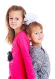 Two adorable little girls sisters are pressed Stock Image