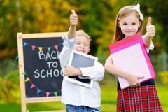 Two adorable little kids going back to school Stock Images