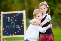 Two adorable little schoolkids feeling excited about going back to school Stock Photos