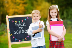 Two adorable little schoolkids feeling excited about going back to school Royalty Free Stock Photography