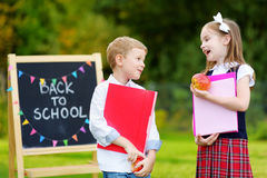 Two adorable little schoolkids feeling excited about going back to school Royalty Free Stock Photos