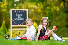 Two adorable little schoolkids feeling excited about going back to school. Two adorable little schoolkids feeling very excited about going back to school Stock Image