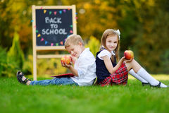 Two adorable little schoolkids feeling excited about going back to school Royalty Free Stock Images