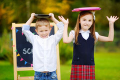 Two adorable little schoolkids feeling exited about going back to school Royalty Free Stock Images