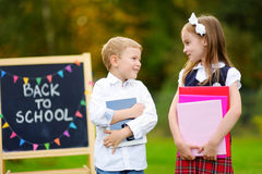 Two adorable little schoolkids feeling exited about going back to school Stock Image