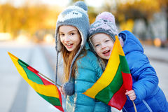 Two adorable little sisters celebrating Lithuanian Independence Day Stock Images