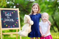 Two adorable little sisters going back to school Stock Photography