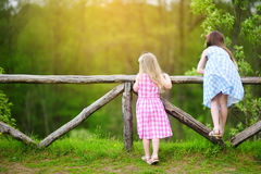 Two adorable little sisters having fun on sunny summer day Stock Images