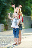 Two adorable little sisters having fun together on warm and sunny summer evening in Desenzano del Garda town, Italy. Two adorable little sisters having fun royalty free stock photos