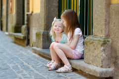 Two adorable little sisters laughing and hugging Royalty Free Stock Images