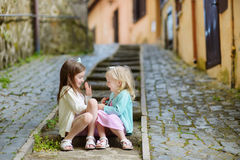 Two adorable little sisters laughing and hugging Stock Image