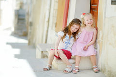Two adorable little sisters laughing and hugging Royalty Free Stock Image