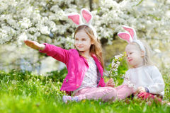 Two adorable little sisters playing with Easter eggs on Easter day Stock Photography