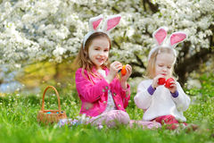 Two adorable little sisters playing with Easter eggs on Easter day Stock Image