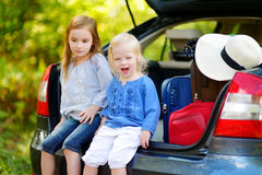 Two adorable little sisters sitting in a car Royalty Free Stock Photo