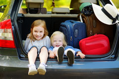 Two adorable little sisters sitting in a car Royalty Free Stock Photography