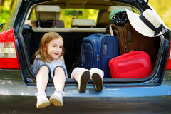 Two adorable little sisters sitting in a car Stock Photography