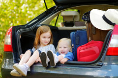 Two adorable little sisters sitting in a car Stock Images
