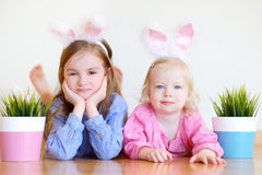 Two adorable little sisters wearing bunny ears on Easter Royalty Free Stock Images